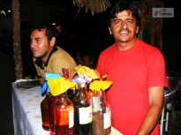 Espaço para venda dos Licores de Olga, no Rancho do Tropeiro em 2010. Em destaque, Saulo Moreno e Neto Novaes, membros da Catrop.
